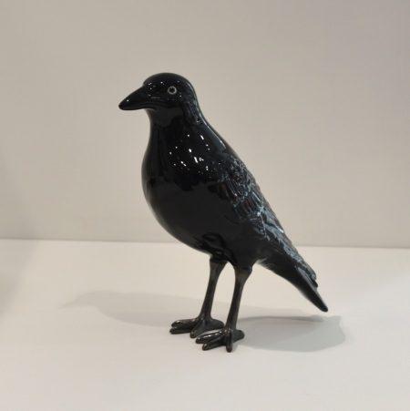 cuervo de cerámica
